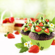 Decorated chocolate cupcake with strawberry. — Stock Photo
