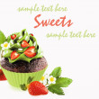 Stock Photo: Decorated chocolate cupcake with strawberry.