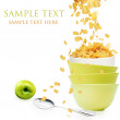 Golden cornflakes falls into the stack of yellow bowls — Stock Photo #26193783