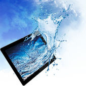 Water splash from tablet computer. — Stock Photo