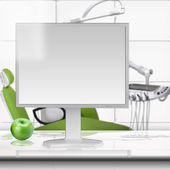 Computer and green apple on the table. Dental office. — Stock Photo