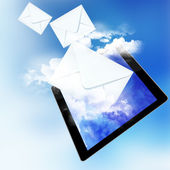 Tablet and fly envelopes. — Stock Photo