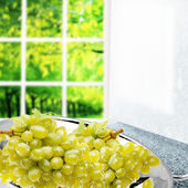 Fresh grapes in a colander. — Stock Photo