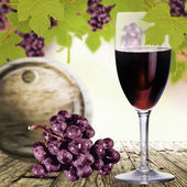 Glass of wine and grapes on wooden table. — Stock Photo