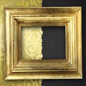 Golden frame over elegant wallpaper — Stock Photo