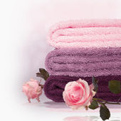 Bright towels with roses. — Stock Photo
