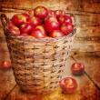 Basket of apples on the old wooden table.  — Stock Photo