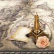 Miniature Eifffel-tower on the old map background. — Stock Photo