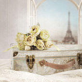 Vintage background with suitcase, bouquet of rose and Eiffel tower. — Stock Photo