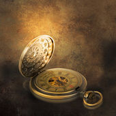 Stylish pocket watch on the grunge background. — Stock Photo