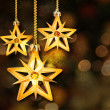 Golden stars on the Christmas background.  — Stock Photo