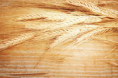 Wheat Ears on the Wooden Table. — Stock Photo