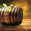 Barrel with fresh grapevine. — Stock Photo