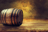 Old barrel on a wooden table. — Stock Photo