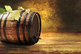 Barrel with fresh grapevine. — Stock Photo