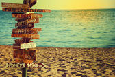 Travel and vacation concept. Direction to different places of the world indicated on the sign. — Stock Photo