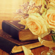 Pastel roses and old books on wooden table.  — Stock Photo