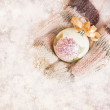 Female hands in mittens Christmas tree ball, on snow background. — Стоковая фотография