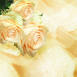 Beautiful roses on a gentle lace — Stock Photo