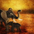 Mother with baby elephants walking outdoors over sunset. Grunge background. — Stock Photo
