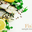 Fresh trout with lemon and spices on white background. — Stock Photo #35547445