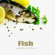 Fresh trout with lemon and spices on white background. — Stock Photo #35547451