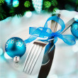 Stock Photo: Table setting for christmas with blue ribbon.