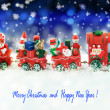 Santa Claus in a toy train with gifts, snowman and christmas tree. — Stock Photo #36317623