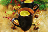 Cups of mulled wine with spices. — Stock Photo