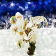 Two Santa Clauses on the winter background. — Stock Photo