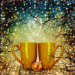 Christmas holiday mugs on wooden table over Christmas tree bokeh background  — Stock Photo