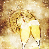 Champagne glasses and clock at midnight — Stock Photo