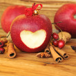 Photo: Red apple with heart shape.