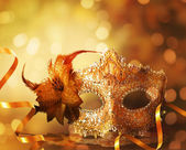 Female carnival mask with golden background — Stock Photo