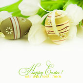 Easter eggs with tulip flowers isolated on white background — Stock Photo