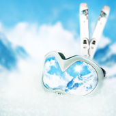 Ski goggles with reflection on slope of mountains. — Stock Photo