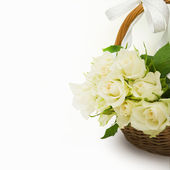 Wicker basket of white roses — Stock Photo