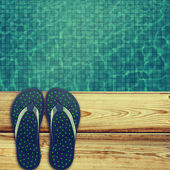 Flip flops near swimming pool. — Stockfoto