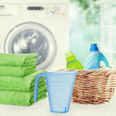 Washing powder, liquid laundry detergent, towels and washing machine. — Stock Photo