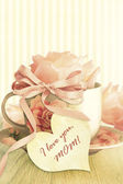 Beautiful pastel roses in a cup. Mother's day card. — Stock Photo