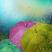 Colorful umbrellas in the rain — Stock Photo