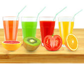Juice on a wooden background — Stock Photo
