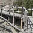 Wooden bridge over ravine — Stock Photo