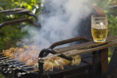 Cooking shashlik on grill — Stock Photo