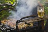 Cooking shashlik on grill — Stock Photo