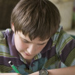 Writing boy — Stock Photo