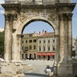 Roman triumphal arch - Stock Photo