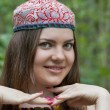 Stock Photo: Pretty young womin Uzbek skullcap
