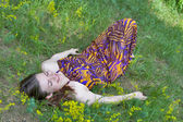 Pretty woman lying on the meadow — Stock Photo