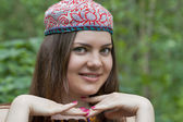 Pretty young woman in a Uzbek skullcap — Stock Photo
